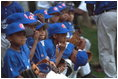 Action became a nail biter in the Memphis Red Sox dugout during a tee-ball game on the South Lawn May 6, 2001.