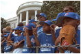 The Memphis Red Sox of the Satchel Paige Little League in Washington, D.C. watch as the President arrives May 6, 2001.