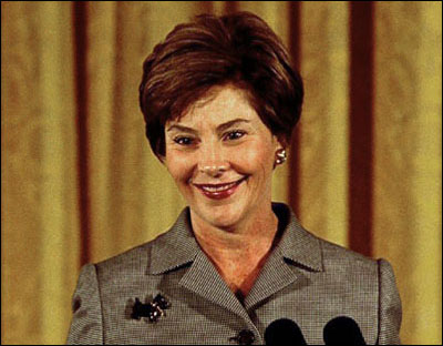 Laura Bush speaks at the National Awards for Museum and Library Services in the East Room October 29, 2002. White House photo by Susan Sterner.