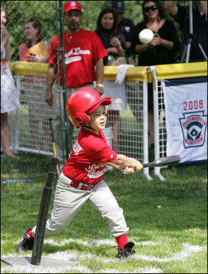 A player for the Cramer Hill Little League Rex Sox of Camden, N.J. hits the ball during the season opening game of the 2008 Tee Ball on the South Lawn Monday, June 30, 2008, on the South Lawn of the White House playing against the Jose M. Rodriguez Little League Angels of Manatí, Puerto Rico.