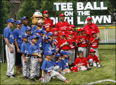Teams participating in the opening game of the 2008 Tee Ball on the South Lawn, the Cramer Hill Little League Red Sox of Camden, N.J., and the Jose M. Rodriguez Little League Angels of Manatí, Puerto Rico, pose together Monday, June 30, 2008, for a photo on the South Lawn of the White House.