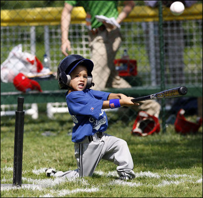 A player of the Jose M. Rodriguez Little League Angels from Manatí, Puerto Rico hits the ball during the 2008 Tee Ball on the South Lawn Season Opener Monday, June 30, 2008, on the South Lawn of the White House.