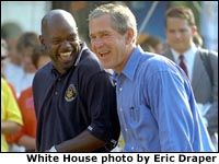 President George W. Bush and Dallas Cowboy Emmitt Smith take in the excitement of the White House Fitness Expo on the South Lawn.