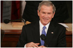 President George W. Bush smiles as he's applauded during Tuesday's 2006 State of the Union address.