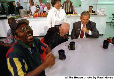 President George W. Bush visits the St. Augustine Parish Hunger Center in Cleveland, Ohio. White House photo by Paul Morse.