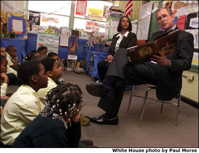 President Bush reads to elementary school students in Washington, D.C. White House photo by Paul Morse.
