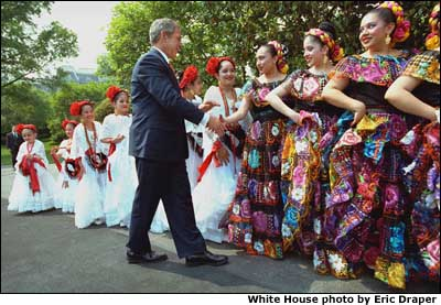 President George W. Bush greets dancers before their performance during Cinco de Mayo festivities at the White House. White House photo by Eric Draper.