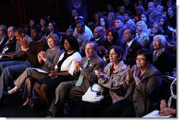 Mrs. Laura Bush applauds while listening to a panel discussion, flanked by NBA player Greg Oden, left, and student, Shantel Monk. Also seated with Mrs. Bush, at right, are Oregon Governor Theodore (Ted) Kulongoski and his, wife, Mrs. Mary Oberst. White House photo by Shealah Craighead