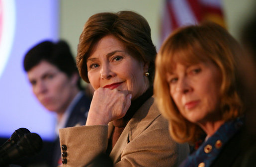 Mrs. Laura Bush listens to panel members during her participation is a roundtable discussion on the special needs of military youth and families Wednesday, Dec. 5, 2007, at the Learning Center at Andrews Air Force Base in Maryland. White House photo by Joyce N. Boghosian
