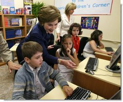 "Mrs. Laura Bush joins youngsters at the opening of the American Children's Corner at Sofia City Library Monday, June 11, 2007, in Sofia. Mrs. Bush said, ""The books in this American Corner tell the story of the United States, describing my country's history, culture and diverse society. In these books, children in Sofia can discover literature that children in the United States enjoy.""  White House photo by Shealah Craighead"