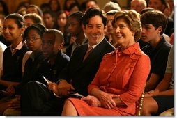 Mrs. Laura Bush and Joe Torsella, President of the National Constitution Center, listen to performance for school children noting the 221st anniversary of the signing of the United States Constitution on Constitution Day. The program, in the East Room of the White House on Sept. 17, 2008, was designed to help make the children more aware of United States History. Mrs. Bush pointed out that Constitution Day is designed to encourage Americans to learn more about our country's founding documents. The performance was part of the six-year-old We the People program created by President George W. Bush. White House photo by Joyce N. Boghosian