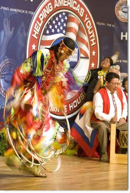 A member of The Seven Falls Indian Dancers performs during the second regional Helping America's Youth Conference on Friday, August 4, 2006, in Denver, Colorado. The dancers are from the Pawnee, Flandreau Santee-Sioux Crow Creek Sioux, and Cheyenne River Sioux tribes. The troupe has been dancing throughout Colorado for over 25 years. White House photo by Shealah Craighead