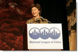 Mrs. Laura Bush addresses an audience Tuesday, March 14, 2006 at the National League of Cities Conference in Washington, asking for their communities continued support of the Helping America's Youth initiative. White House photo by Shealah Craighead