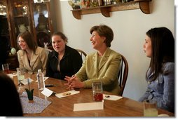 Mrs. Laura Bush shares in laughter with girls who are living in a family-style residential group home at Father Flanagan's Girls & Boys Town in Omaha, NE, Monday, April 3, 2006. Girls and Boys Town was founded in 1917 to help troubled boys. Today there are more than 100 long-term, residential-care homes for trouble youths, featuring family-style living in the least restrictive environment. White House photo by Shealah Craighead
