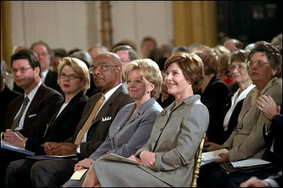 Laura Bush and Lynne Cheney sit with Education Secretary Rod Paige during the White House Conference on Preparing Tomorrow's Teachers, March 5, 2002.