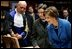 Laura Bush looks at an Ancient Thesis of Montichelli during a tour given by Paolo Novaria, Archives, left, at the University of Turin Saturday, Feb. 11, 2006, in Turin, Italy.
