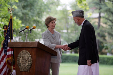 Mrs. Laura Bush shakes hands with President Hamid Karzai of Afghanistan, Sunday, June 8, 2008, during their press availability at the presidential palace in Kabul. White House photo by Shealah Craighead