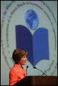 """Mrs. Laura Bush address the White House Symposium on Advancing Global Literacy: Building a Foundation for Freedom, which convened at New York City's Metropolitan Museum of Art in New York City, Sept. 22, 2008. With a projection screen display to her side, Mrs. Bush noted that """"literacy is at the core of sustainable solutions to the world's greatest problems."""" Worldwide more than 770 million adults live without literacy skills. White House photo by Chris Greenberg"""
