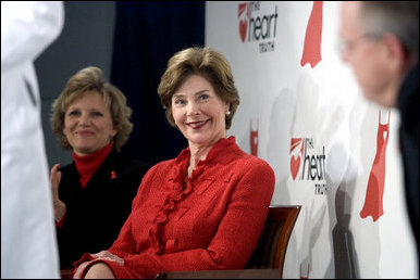 Laura Bush sits with Lois Ingland, a heart disease survivor, during an event at the Carolinas Medical Center Wednesday, Feb. 15, 2006, in Charlotte, NC. Despite having none of the risk factors of heart disease, Lois, a mother of four, suffered a heart attack when she was 36 years old. White House photo by Shealah Craighead