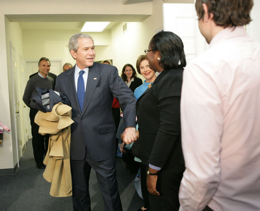 With Mrs. Laura Bush by his side, President George W. Bush speaks to reporters Monday, Dec. 22, 2008, during a visit to the Pathways to Housing DC, a distribution site for the One Warm Coat Holiday Service Project, in Washington, D.C. Modeled after the first Pathways to Housing program in New York City founded in 1992, Pathways to Housing DC works with individuals who have been turned away from other programs. White House photo by Shealah Craighead