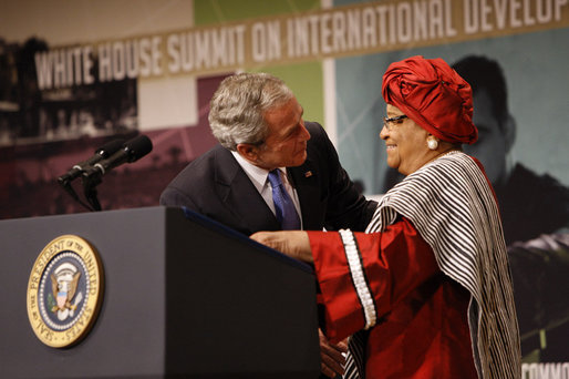 After being introduced President George W. Bush embraces Liberian President Ellen Johnson Sirleaf at the White House Summit Tuesday, Oct. 21, 2008, in Washington, D.C. President Bush discussed in his remarks core transformational goals of country ownership, good governance, results-based programs and accountability, and the importance of economic growth. White House photo by Eric Draper