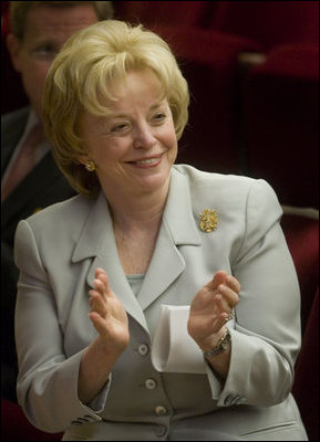 Mrs. Lynne Cheney applauds the group of naturalized American citizens as they stand to participate in the swearing in ceremony during a special naturalization ceremony at the National Archives Tuesday, April 17, 2007, in Washington, D.C. White House photo by Lynden Steele