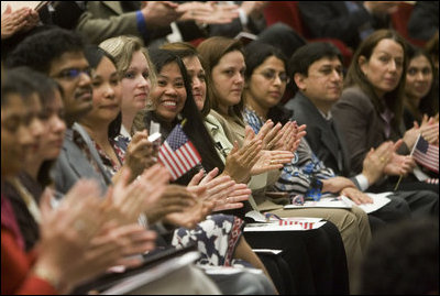 Arlene Oftedahl of Burke, Va., center, is all smiles as she and some of America's newest citizens applaud Mrs. Cheney as she delivers her remarks during a special naturalization ceremony at the National Archives Tuesday, April 17, 2007, in Washington, D.C. White House photo by Lynden Steele