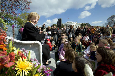 """Lynne Cheney reads from her book, """"America: A Patriotic Primer,"""" at the White House Easter Egg Roll Monday, April 21, 2003. Accompanying Mrs. Cheney, several Cabinet members and authors also read to children during the day."""