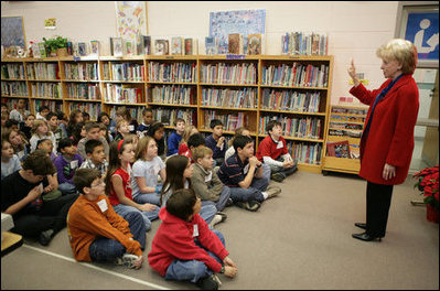 Mrs. Cheney holds up her finger as she describes to students at W.W. Burrows Elementary School in Quantico the procedure for casting votes in the upcoming parliamentary elections in Iraq and its importance. Mrs. Cheney spoke to the kids Tuesday, Dec. 13, 2005, on the U.S. Marine Corps base.