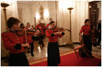 Roving musicians enter the State Dining Room, Monday, July 18, 2005 at the White House, at the official dinner in honor of the visit by India's Prime Minister Dr. Manmohan Singh. White House photo by Eric Draper