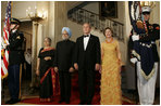 President George W. Bush, Laura Bush and India Prime Minister Dr. Manmohan Singh and Mrs. Gursharan Kaur, arrive for the official dinner in the State Dining Room at the White House Monday, July 18, 2005. White House photo by Krisanne Johnson