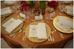 The table setting for President Bush is seen prior to the start of the official dinner, Monday, July 18, 2005 at the White House, in honor of the visit by India's Prime Minister Dr. Manmohan Singh. White House photo by Eric Draper