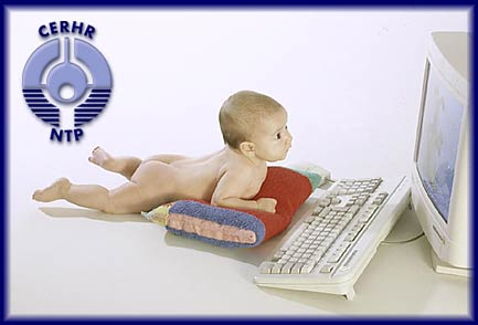 picture of baby in front of a computer