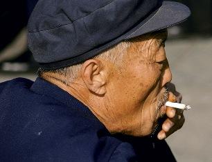 A Chinese man smoking a cigarette.