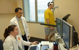 Dr Chen and staff testing exercise monitoring software