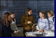 photo of female science students meeting with female science teacher