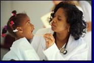 photo of female doctor examining female patient