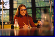 photo of female college student working in a laboratory