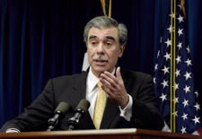 Secretary at podium with U.S. flag in background.