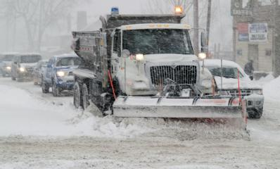 snowplow clearing city streets