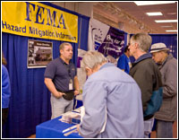 Mitigation specialist Jose Ruvira talks with visitors to the FEMA Mitigation booth at the Grays Harbor Trade Fair