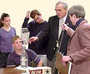 A senior scientist explains the theory behind his soda bottle experiment to middle school students during a live Web interview.