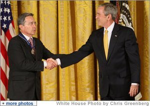 President George W. Bush congratulates President Alvaro Uribe of Colombia after presenting him with the 2009 Presidential Medal of Freedom Tuesday, Jan. 13, 2009, during ceremonies in the East Room of the White House. White House photo by Chris Greenberg
