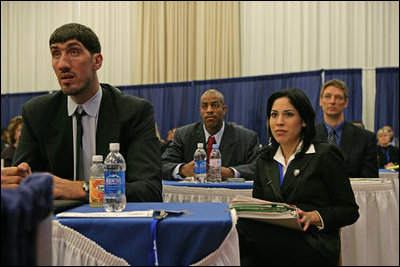 Representatives of the National Basketball Association, former NBA player Gheorghe Muresan, left, NBA players Jerome Vernon WIlliams, background-left, and Detlef Schrempf, background-right, now retired, attend the the White House Conference on Helping America's Youth, Thursday, Oct. 27, 2005 at Howard University in Washington. White House staff member Sonya Medina is seen at right.