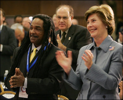 Laura Bush and Louie Culver give Culver's daughter, Sarah Tucker, a standing ovation at the completion of her award winning essay, Thursday, Oct. 27, 2005 at Howard University in Washington, at the White House Conference on Helping America's Youth.