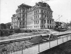 Photo showing the construction of the South and East wings of the EEOB, 1874 (NARA)