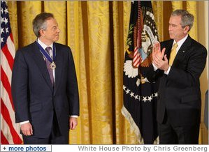 President George W. Bush applauds former Prime Minister Tony Blair after presenting him Tuesday, Jan. 13, 2009, with the 2009 Presidential Medal of Freedom during ceremonies in the East Room of the White House. White House photo by Chris Greenberg