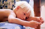 A boy lying on a sofa