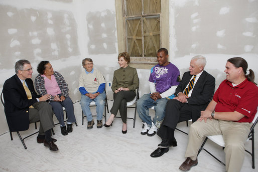 Mrs. Laura Bush visits with Mr. Jim Kelly, CEO and co-president of Catholic Charities Archdiocese of New Orleans, left; homeowner Mrs. Joeretta Roman, Ms. Nancy Parlin, Consociate Candidate, Sisters of St. Joseph of the Province of St. Paul, third from left; Mr. Ashton Johnson, student YouthBuild Helping Hands; Mr. Doug O'Dell, Federal Coordinator, Office of the Federal Coordinator for Gulf Coast Rebuilding, 2nd right, and Mr. Kevin Fitzpatrick, Volunteer Housing Coordinator, Operation Helping Hands, right, Thursday, October 30, 2008, in New Orleans, La., during a tour of the home of Joretta Roman which is being rennovated by Catholic Charities Operation Helping Hands after sustaining damage from Hurricane Katrina. White House photo by Chris Greenberg