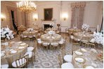 The tables are set and ready for guests, Wednesday, Nov. 2, 2005, in the White House State Dining Room, in preparation for the official dinner for the Prince of Wales and Duchess of Cornwall.